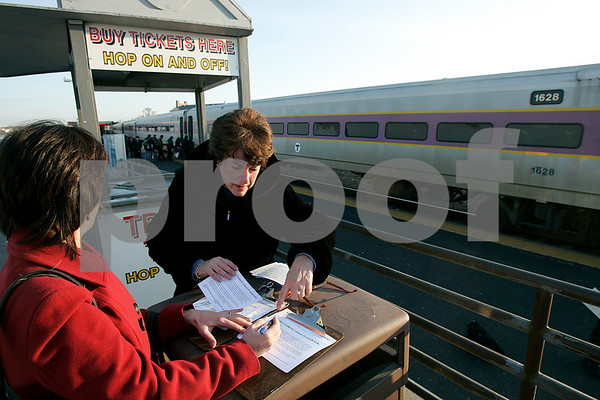 Salem: Deborah Delaney from the  Salem Partnership explains the petition to Susan Baccari of Salem at the Salem train station early yesterday morning. The  Salem Partnership were at the station collecting signatures from train riders urging the state to build a new MBTA parking garage in Salem. Photo by Mark Lorenz/Salem News