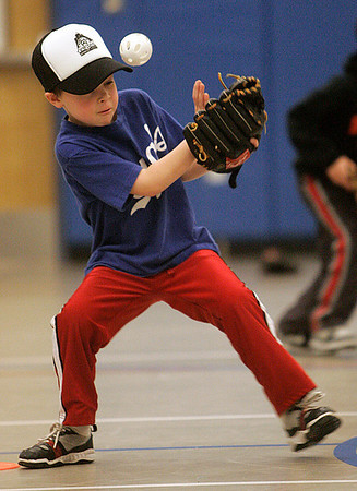 Beverly: Carson Brean, tries to haul in this ground ball during Beverly Little League's 2011 Winter Clinics. The clinics are for players age 5 through 9 years of age and are at the North Beverly High Elementary School on January 16, 23 & 30th. Photo by Mark Lorenz/Salem News