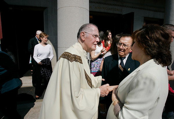 Danvers: Father Gerard Dorgan of St Mary of The Annunciation Parish greets parishers after Easter mass.  Photo by Mark Lorenz/Salem NewsPhoto by Mark Lorenz/Salem News