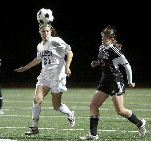 Peabody: Peabody High's Hayley Dowd and Newton North's Sarah Perlo in playoff game at Bishop Fenwick High School. Photo by Mark Lorenz/Salem News
