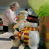 Salem: Karyn Reardon secretary at the Bates School browses items during a silent auction. Bates School staff donated gifts, gift baskets, crafts and other items to help raise money for UNICEF for relief to Haiti. Reardon dontated two tickets to a Boston Celtics game. Photo by Mark Lorenz/Salem News