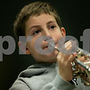 Beverly: Matthew Zieff, 10, a fifth-grader at North Beverly Elementary School practices his trumpet during morning band practice. Elementary school band participation dropped dramatically this year, and school officials think it's because the program was changed to 7:30 a.m. Photo by Mark Lorenz/Salem News