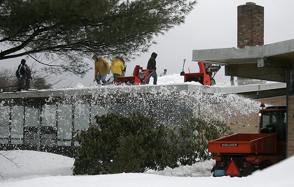 Hamilton: Custodians and town workers clear the roof and entrances to the Winthrop School in Hamilton. The school district is not in session due to the amount of snow on the schools roofs. Photo by Mark Lorenz/Salem News