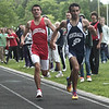 Hamilton: Masconomet Ben Hiromura and Hamilton-Wenham's Chris Benevento cross at the same time in the 2 miler at 9:59. Photo by Mark Lorenz/Salem News