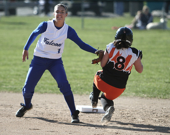 Danvers: Ispwich High School Maddie Pinciaro is tagged out second base by Danvers High Gabby Vega, after an attempted steal. photo by Mark Lorenz/Salem News