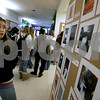 Salem: Salem High School student, Kacie Zukowski, speaks about her photographs, during the Deck the Halls annual student art show at Salem High School. Photo by Mark Lorenz/Salem News