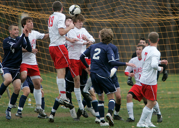 Topsfield: Masco's #18 D.J. Clark heads the ball in front of Lincoln-Sudbury's goal in Division 1 North quarterfinal. Staff by/Mark Lorenz