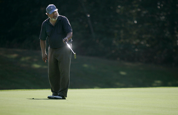 Boxford: Bob Avellino, watches his putt at hole four, during the North Shore Amateur Golf Tournament. Avellino plays at Far Corners Golf Course, where the tournament took place. Photo by Mark Lorenz/Salem News<br /> , Boxford: Bob Avellino, watches his putt at hole four, during the North Shore Amateur Golf Tournament. Avellino plays at Far Corners Golf Course, where the tournament took place. Photo by Mark Lorenz/Salem News