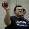"Peabody: Peabody's Athan Goulos throws for 39' 4"" during track meet against Beverly. Photo by Mark Lorenz/Salem News"