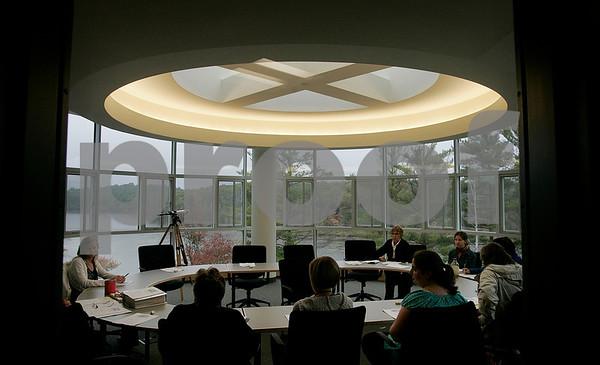 Wenham: Faculty members meet on the third floor conference room of the Ken Olsen Science Center, Gordon College. Photo by Mark Lorenz/Salem News