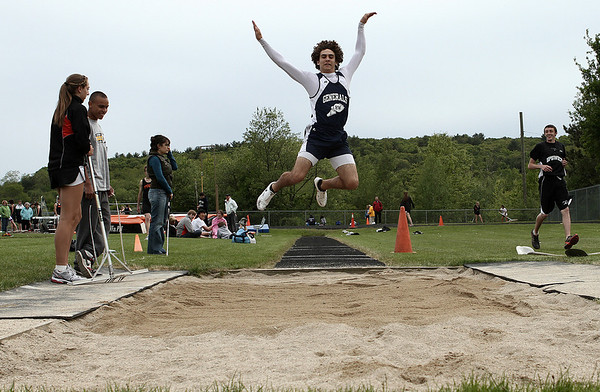 Ipswich: Hamilton-Wenham track star Jackson MacDonald in boys long jump in meet at Ipswich High. Photo by Mark Lorenz/Salem News