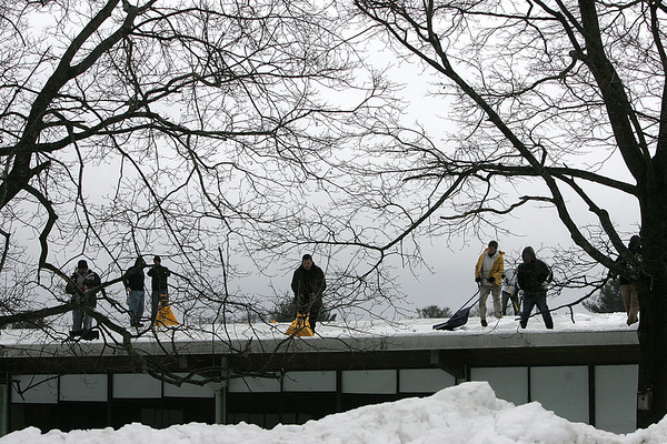 Hamilton: Hamilton-Wenham schools are not in session due to the amount of snow on the schools roofs. Here, workers clear the Winthrop School roof  in Hamilton. Photo by Mark Lorenz/Salem News
