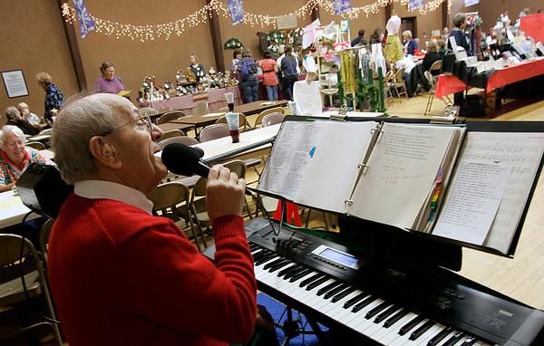 Beverly: Joe Boccia, performs Christmas songs during the annual First Baptist Church's church fair. Boccia a church member has been performing at the church fair for twenty years. Photo by Mark Loren/Salem News