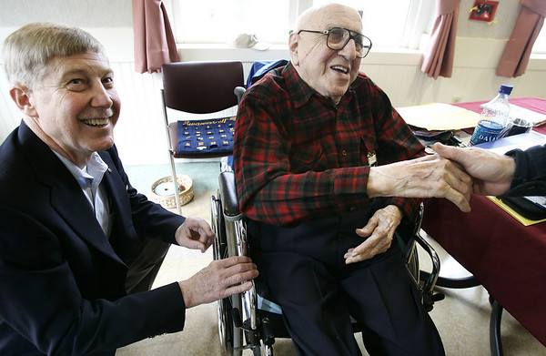 Swampscott: David Sherman, a long time Swampscott Rotarian, turns 100. A member of the rotary club for 75 years, pauses from talking to Buck Weaver, left, treasurer for the club to greet those wishing him a happy birthday. Photo by Mark Lorenz/Salem News. Wednesday, March 14, 2007