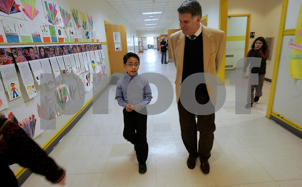 Salem: Saltonstall School fifth-grader, Jonathan Marerro, 10, walks with Beverly native David Ferreiro, who is now the director of the New York City Public Library. Ferreiro read an article on the Salem News's website about Jonathan raising money to help with the school crisis budget. Photo by Mark Lorenz/Salem News