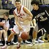 Topsfield: Masco's Adam Bramanti drives to the basket as Hamilton-Wenham's Stephen Tam tires to block him. Photo by Mark Lorenz/Salem News