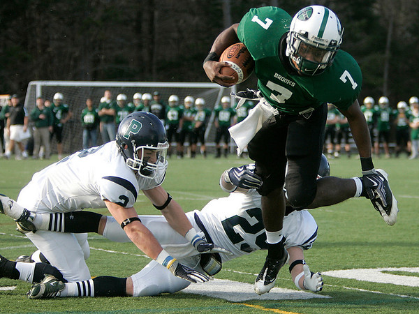 Beverly: Brooks School quarterback Jordan Johnson plows through Pingree Schools John St. Pierre and John Williamson in the Clark/Francis Bowl as part of NEPSAC playoffs, played at Endicott College. Pingree defeated Brooks 7-6. Staff by/Mark Lorenz