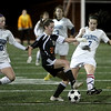 Peabody: Peabody High's Taylor Provost (10) and Angela Ellison work against Newton North's Leah Howard, in playoff game at Bishop Fenwick High School. Photo by Mark Lorenz/Salem News