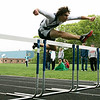 Hamilton: Hamilton-Wenham Regional High's Jackson MacDonald takes an easy win the hurdles in meet against Masconomet. Photo by Mark Lorenz/Salem News