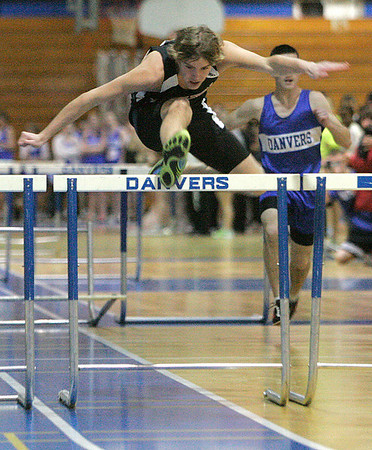 Danvers: Marblehead's Jake Smith takes first in the 55m hurdles at Danvers. Photo by Mark Lorenz/Salem News<br /> <br /> , Danvers: Marblehead's Jake Smith takes first in the 55m hurdles at Danvers. Photo by Mark Lorenz/Salem News