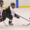 Salem:  Beverly girls hockey player Corinne Woods reaches for the puck followed by Marblehead's Kailey Gillis.  photo by Mark Teiwes / Salem News