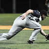 Danvers: Peabody Champions pitcher Mike Moroney reaches for ball to make a play at Twi-Field during the league finals.  Photo by Mark Teiwes / Salem News