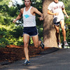 Wenham: Gordon College sophmore Josh Porizky leads in front of Salem State's Alex Gomes on the first lap on the race.  Porizk returns this season after setting the home course record his freshman year.  photo by Mark Teiwes / Salem News