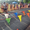 Beverly: Racers push to the finish line at Lynch Park.   photo by Mark Teiwes / Salem News