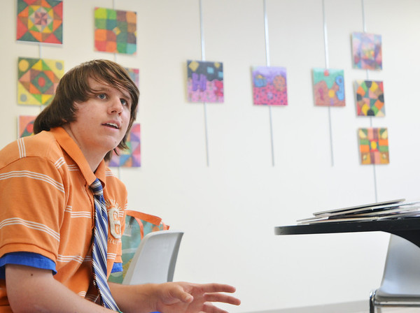 "Danvers: Cameron ""C.J."" Mercier  of Danvers, 19, talks about his art show at the Northeast Arc. He has progressed tremendously since suffering brain damage in a 2006 accident.   photo by Mark Teiwes  / Salem News"
