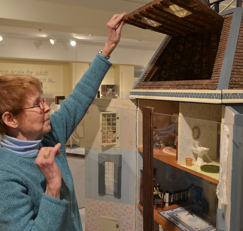 Wenham:  Nancy Shane shows an unfurnished attic in one of her doll houses on display at the Wenham Museum. photo by Mark Teiwes / Salem News