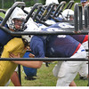 Peabody: Nick Melto, left, is hit during drills in the chute at Peabody High School football practice.  photo by Mark Teiwes / Salem News