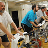 Salem:  City counselors Bob McCarthy, left, Jerry Ryan, Steve Pinto, Paul Prevey, and Executive director at YMCA of the North Shore Debbie Amaral, right, participate in a Spin-a-thon fundraiser for the Salem Y.  photo by Mark Teiwes  / Salem News