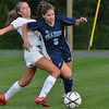 Danvers: Danvers player Delaney Zecha, left, fights for the ball with   Peabody's Cayla Bucci.  photo by Mark Teiwes / Salem News