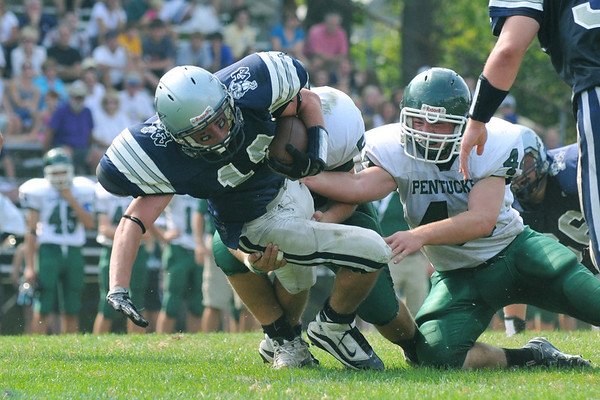 Hamilton: Generals player Trevor Lyons pushes himself past the Pentucket defense to gain the last few yards to score a touchdown in the last minute of the first half photo by Mark Teiwes / Salem News