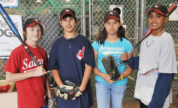 The Salem American Little League all-stars pitchers are Cam Twomey, left, Wesley Schaejbe, Olivia Wadsworth, and Joey Baez.   photo by Mark Teiwes / Salem News