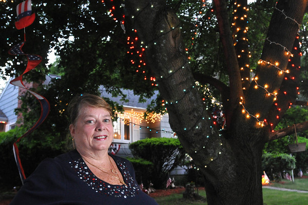 Peabody: Sharon Kokoras decorated her house in red, white and blue for Christmas in honor of her nephew Lt. Commander Gerald P. Flinn III.  She has continued to keep them up as he serves in Iraq.  photo by Mark Teiwes / Salem News