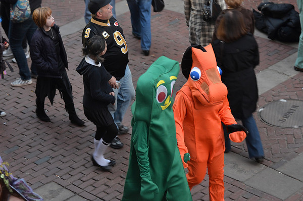 Salem: Gumby and Pokey walk hand-in-hand down Essex Street.  photo by Mark Teiwes / Salem News