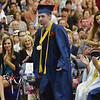 Middleton: North Shore Technical High School valedictorian Benjamin Thomas rises to recieve an award during graduation.  photo by Mark Teiwes / Salem News