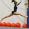 Gloucester: Peabody's Vanessa Avola leaps during her floor routine.  photo by Mark Teiwes  / Salem News