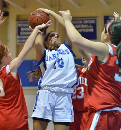 Danvers: Danvers High School player Jannelle Saggesse puts up a shot as she is triple teamed by Wakefield defense.  photo by Mark Teiwes  / Salem News