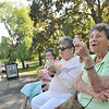 Salem: Irene Jacobs, left, Esta Schachter and Helen Bloom, all from Beverly, celebrate Helen's 86th birthday with some ice cream at the Salem Willows.  photo by Mark Teiwes / Salem News