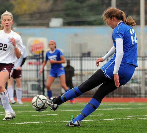 Lynn: Danvers senior Kellie Macdonald rips a shot on the goal.  Danvers had eighteen shots on goal compared to eight from Belmont, but failed to finish.  photo by Mark Teiwes / Salem News