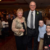 Danvers: Richard Santeusanio, Former Danvers public schools educator was honored for making a difference to the Danvers Public Schools.  Also pictured are his wife Joan and grandchildren Peter, 8, and Kate, 6.    photo by Mark Teiwes / Salem News