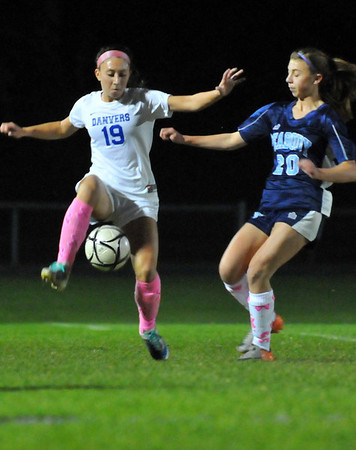 Danvers: Danvers' Alex Strangie, left, traps the ball followed by Peabody's Madison Doherty in last night's Danvers win 2-1 over Peabody.   photo by Mark Teiwes / Salem News