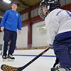 Gloucester: 2-year-old Trevor Nemeskal of Danvers skates with his dad Paul.  photo by Mark Teiwes  / Salem News