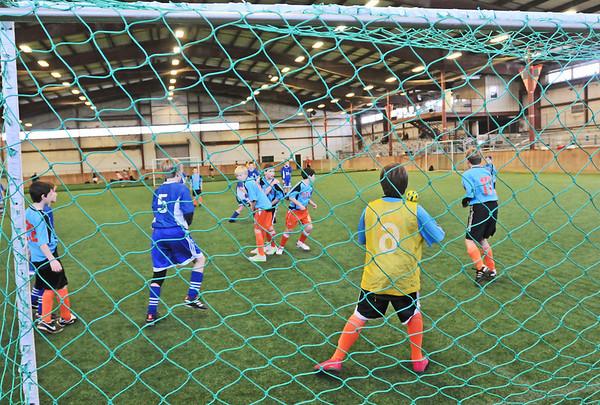 Topsfield: U12 Danvers and Topsfield boys teams play at the Topsfield Fairground areana. photo by Mark Teiwes  / Salem News