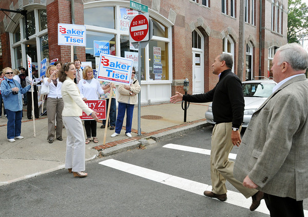 Beverly:  After speaking at the Beverly Democratic campaign office Governor Patrick, center, crossed the street to greet Lauren Baker, left, the wife of Charlie Baker, his Republican opponent with Mayor Bill Scanlon, right, close behind.  photo by Mark Teiwes / Salem News