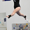 Gloucester: Hamilton-Wenham's Hannah Palmer performs her beam routine.  photo by Mark Teiwes  / Salem News