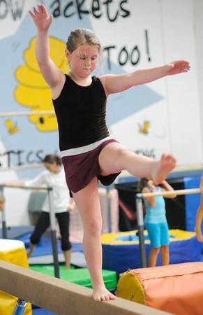 Danvers: Tori Sirois practices her beam routine.