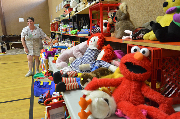 Beverly: Elaine Cunningham volunteers during a fall rummage sale at First Baptist Church in Beverly
